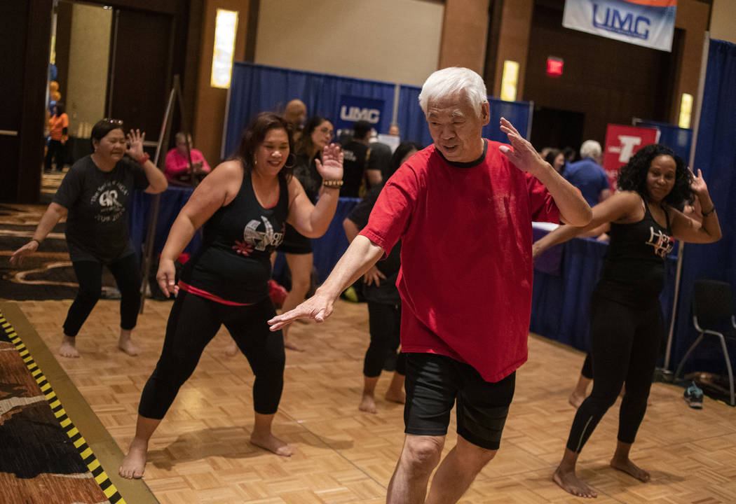 Kunigh Takechi of Summerlin joins Hot Hula fitness for a work out at the AgeWell Expo on Saturd ...