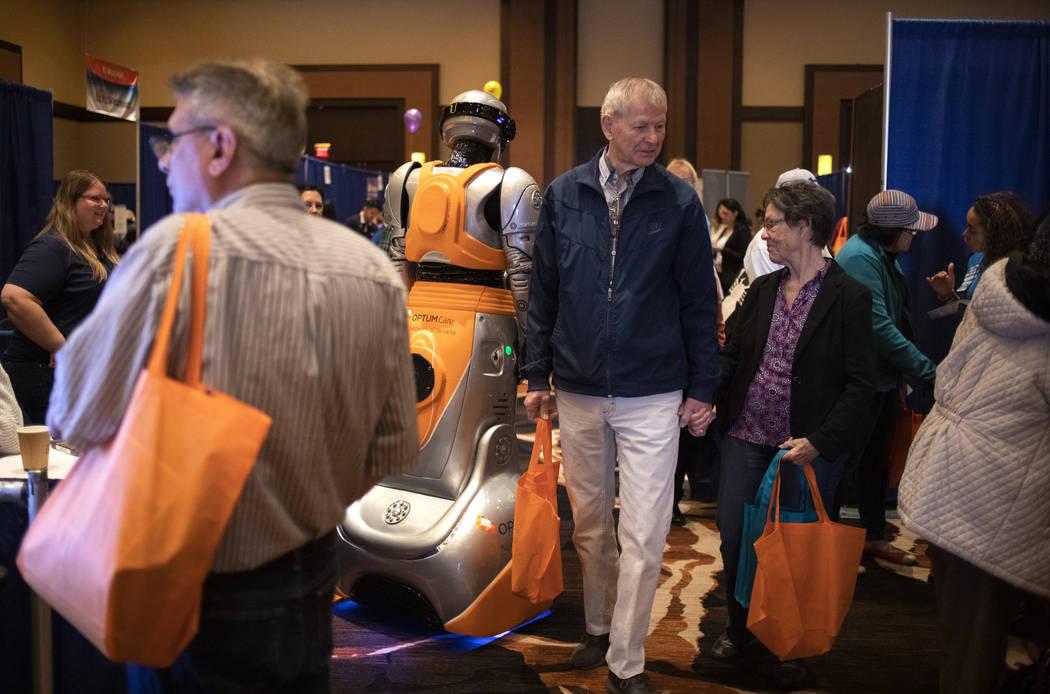 People attend the AgeWell Expo at Red Rock Resort in Las Vegas on Saturday, Nov. 9, 2019.(Ellen ...