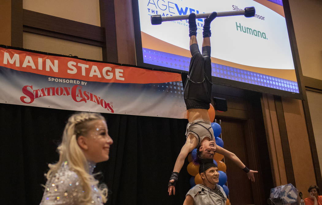 Performers from the show Celestia entertain the crowd at the AgeWell Expo on Saturday, Nov. 9, ...