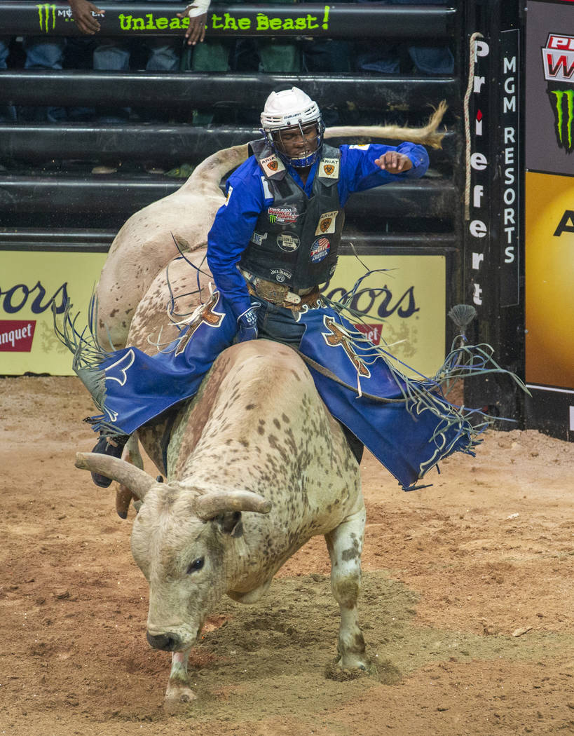 Ezekiel Mitchell dominates Lester Gillis during the third day of the PBR World Finals at T-Mobi ...