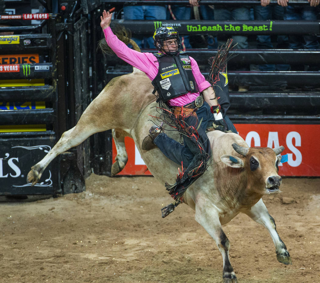 Ramon de Lima leans back on Ridin Solo during the third day of the PBR World Finals at T-Mobile ...