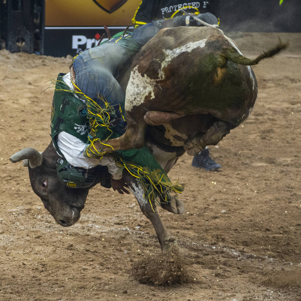 Keyshawn Whitehorse attempts to hang on to Rocket Man during the third day of the PBR World Fi ...