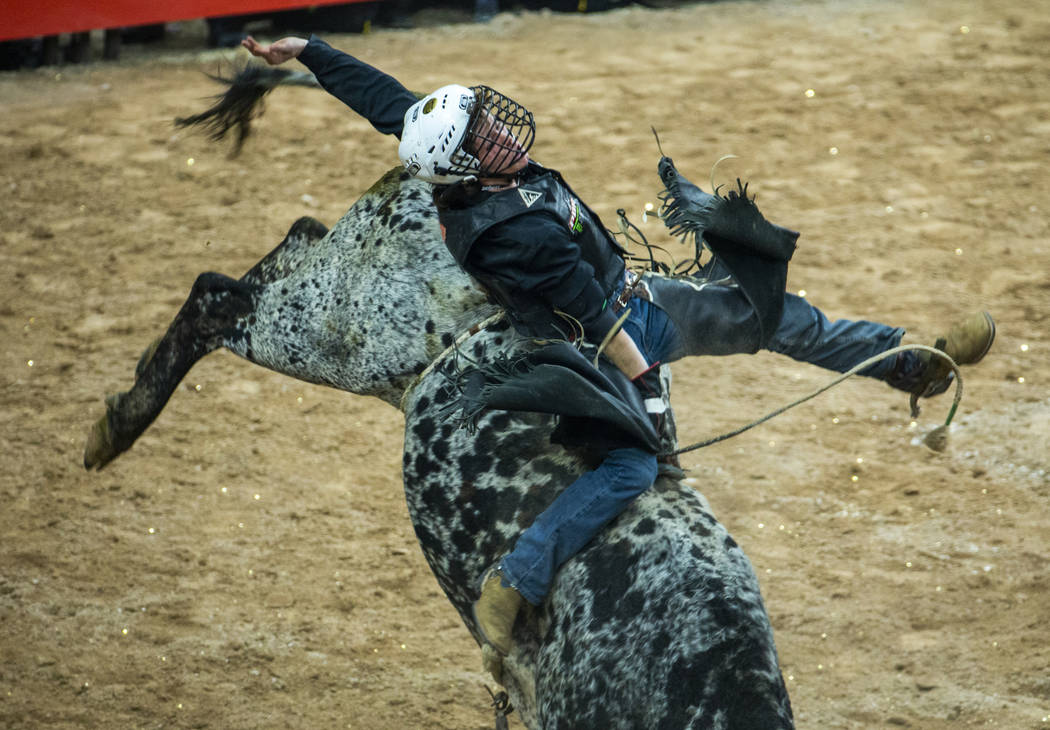 Dylan Smith is bucked on Spotted Snake during the third day of the PBR World Finals at T-Mobile ...