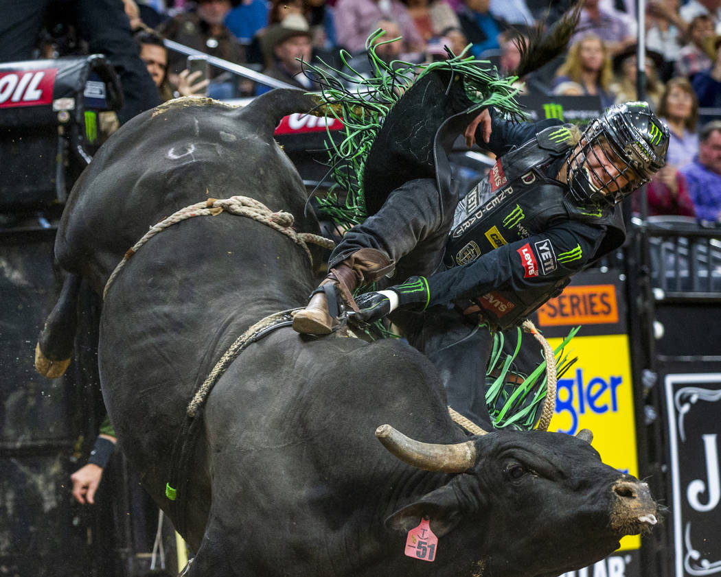 Derek Kolbaba gets sideways atop of Skeeter Peter during the fourth day of the PBR World Finals ...