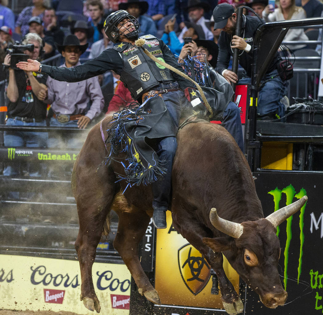 Luciano De Castro sits back atop of Rusty Bones during the fourth day of the PBR World Finals a ...