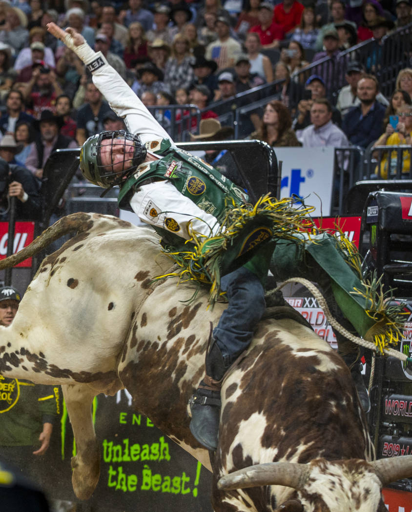 Cooper Davis leans way back on M.A.G.A. during the fourth day of the PBR World Finals at T-Mobi ...