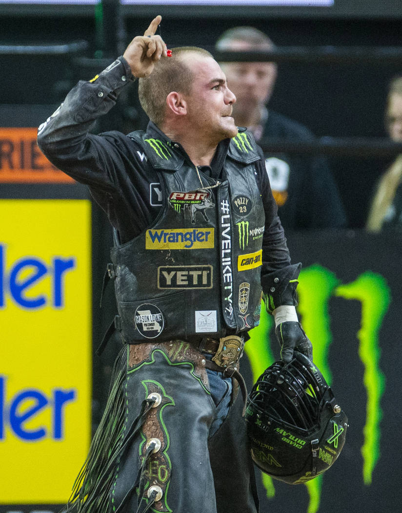 Chase Outlaw celebrates a successful ride on Catch My Drift during the fourth day of the PBR Wo ...