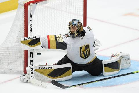 Vegas Golden Knights goaltender Marc-Andre Fleury reaches for the puck during the third period ...