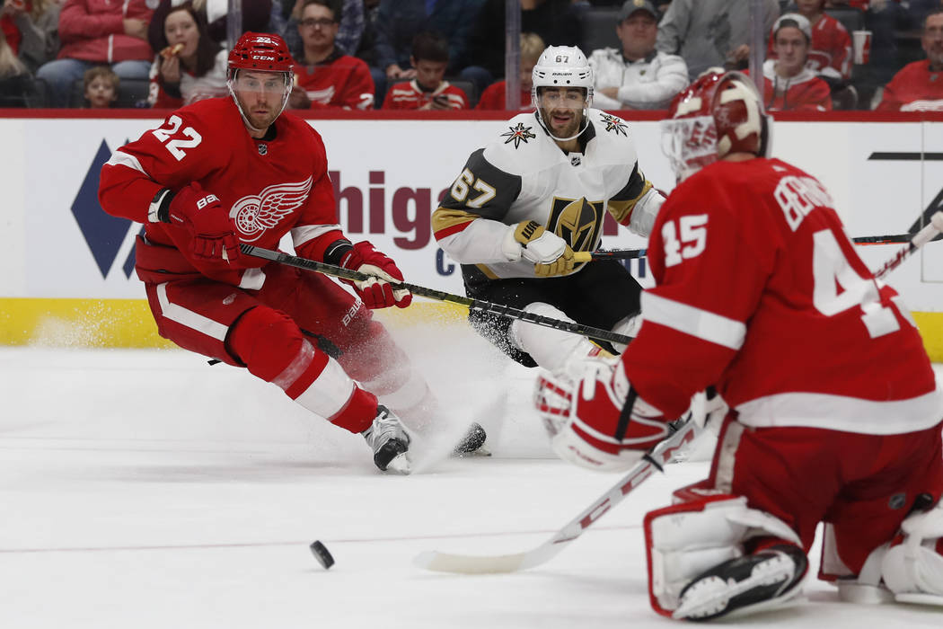 Detroit Red Wings goaltender Jonathan Bernier (45) deflects a shot as defenseman Patrik Nemeth ...