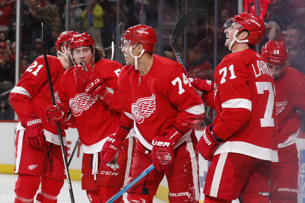 Detroit Red Wings defenseman Madison Bowey (74) is congratulated after scoring during the third ...