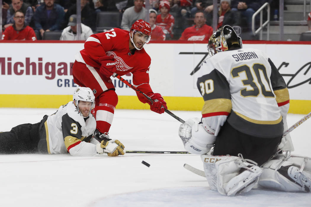 Vegas Golden Knights goaltender Malcolm Subban (30) deflects a shot by Detroit Red Wings center ...