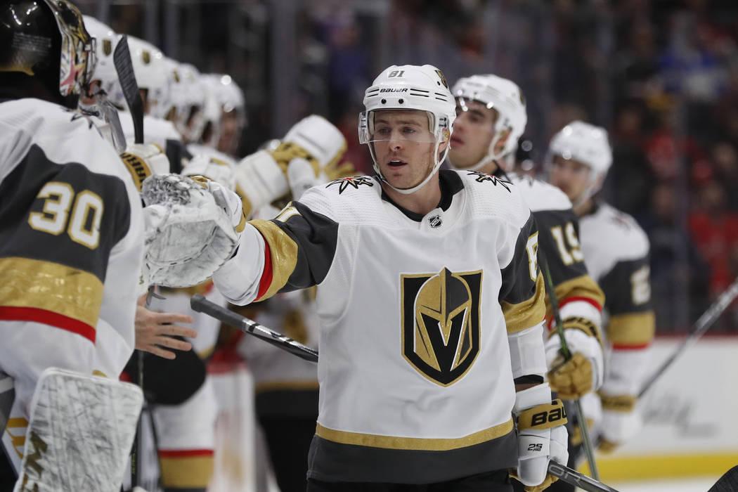 Vegas Golden Knights center Jonathan Marchessault greets teammates after scoring during the fir ...