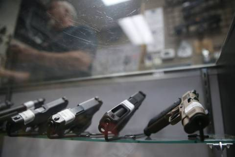 Guns are showcased at 2nd Amendment Gun Shop in Las Vegas, Wednesday, Sept. 4, 2019. (Erik Verd ...