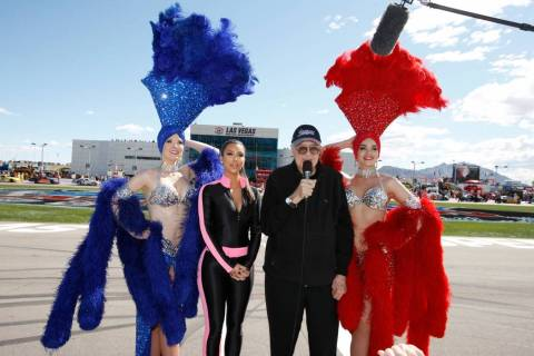 Grand marshals Kim Kardashian (2nd-L) and Caroll Shelby (2nd-R), with Las Vegas Showgirls, give ...