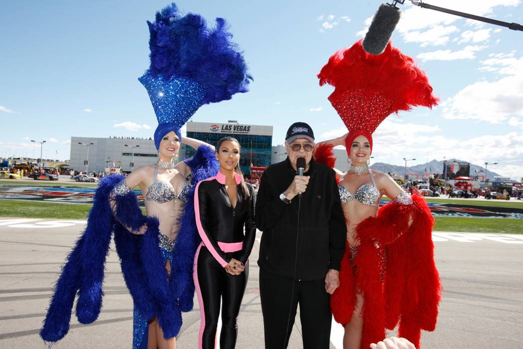 Grand marshals Kim Kardashian (2nd-L) and Caroll Shelby (2nd-R), with Las Vegas Showgirls, give ...