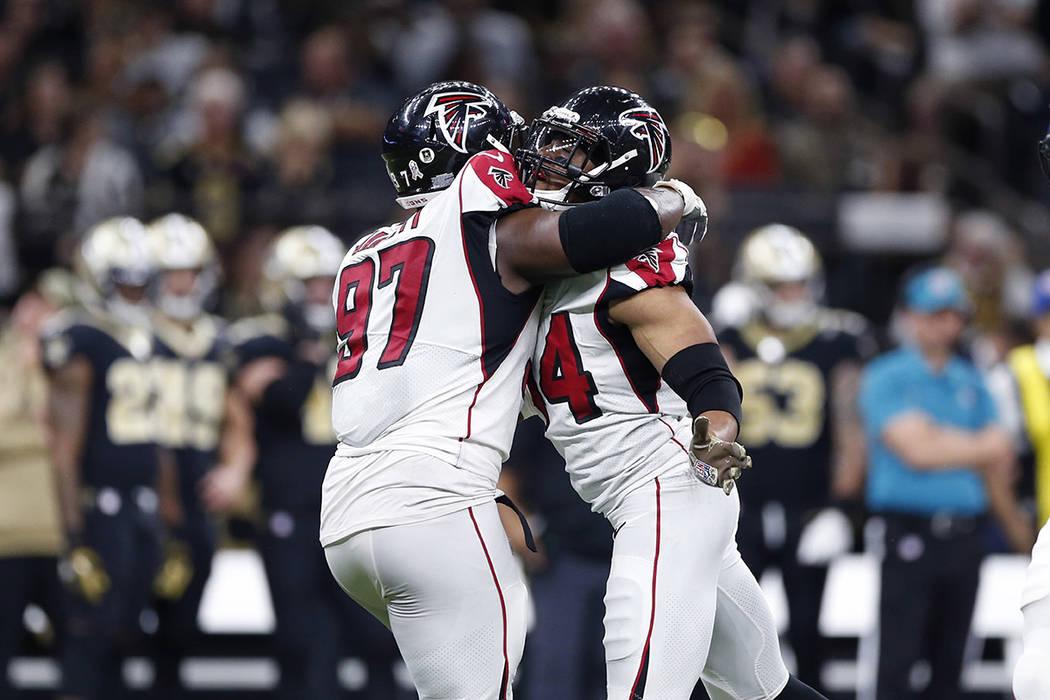 Atlanta Falcons defensive end Vic Beasley (44) celebrates his sack with defensive tackle Grady ...
