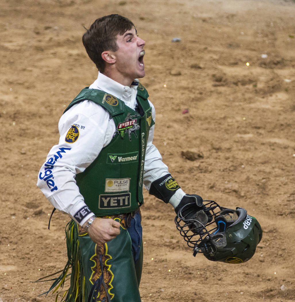 Jess Lockwood celebrates a successful ride on Rising Sun during the last day of the PBR World F ...