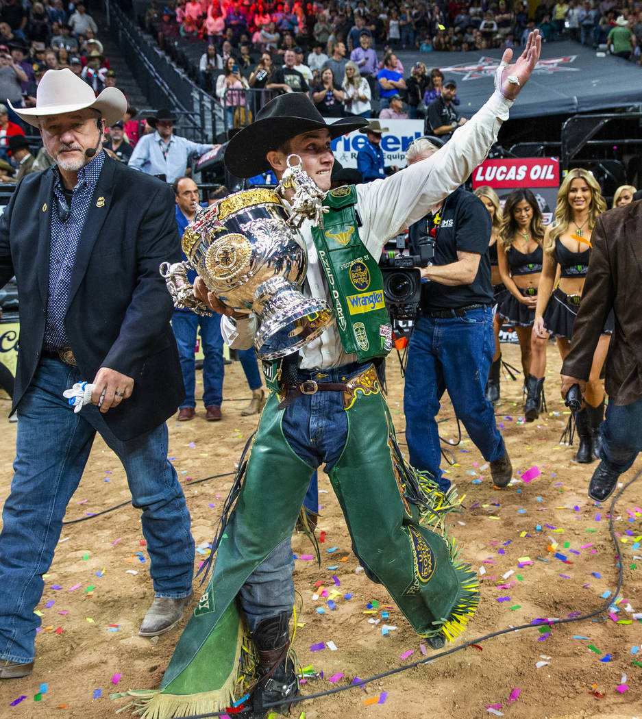 Jess Lockwood walks with his winning trophy after being awarded the 2019 PBR World Finals Champ ...