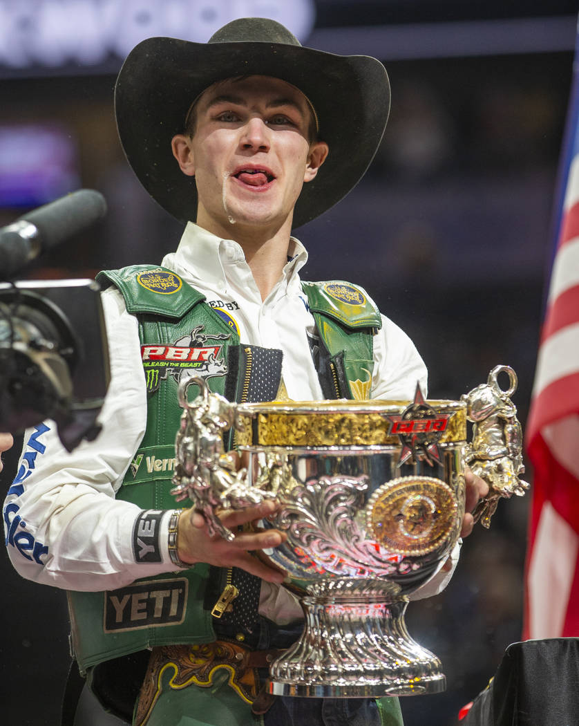 Jess Lockwood laughs after drinking a Coors beer from his winning trophy and being awarded the ...