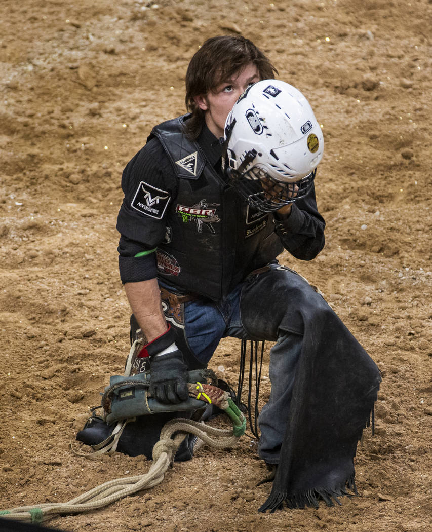 Dylan Smith gives thanks after escaping injury on Oz during the last day of the PBR World Final ...