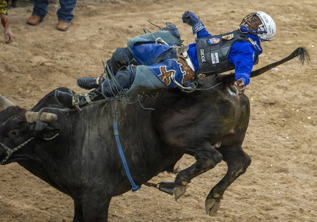 Ezekiel Mitchell is bucked back off of Medicine Man during the last day of the PBR World Final ...