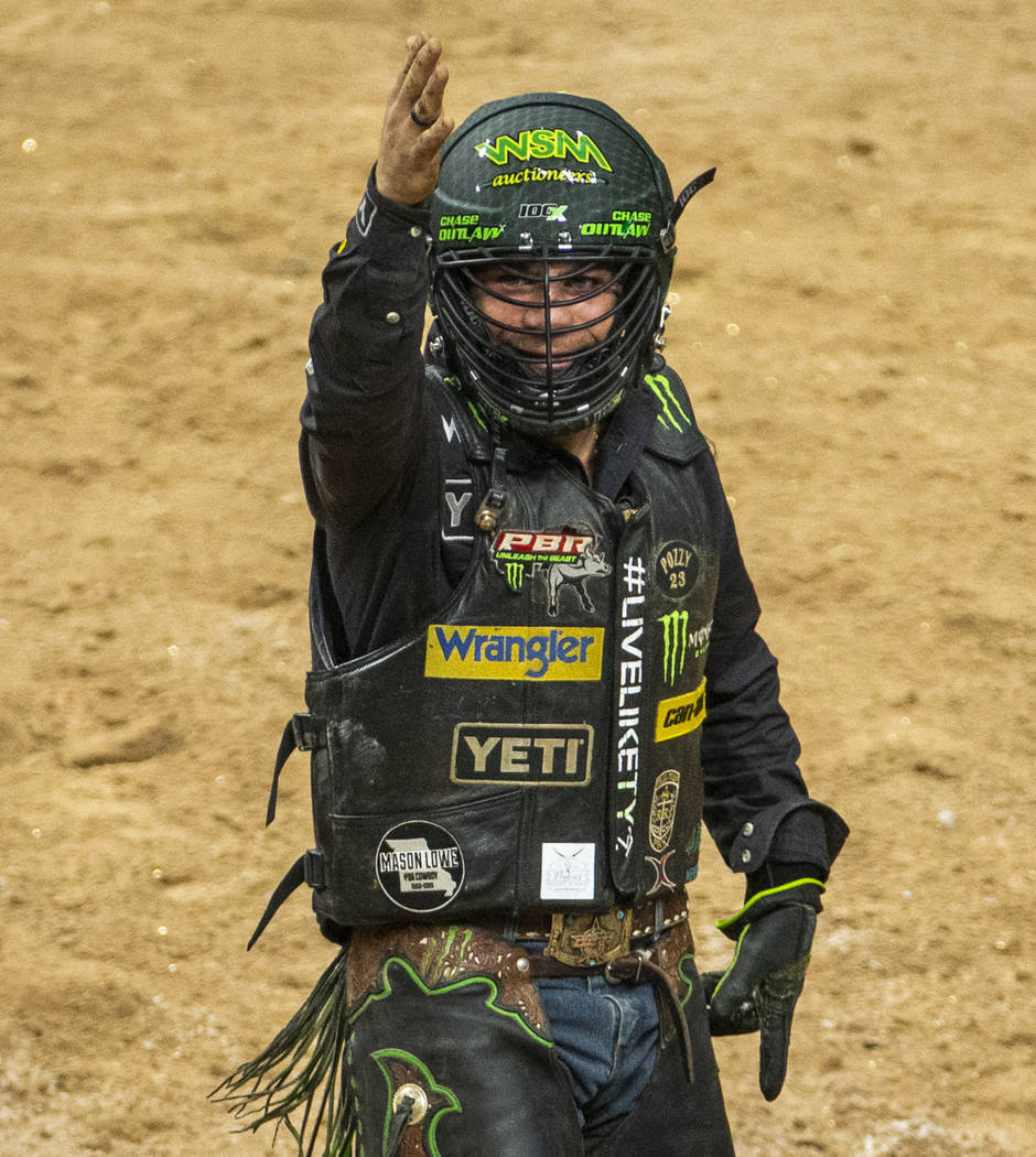 Chase Outlaw is pumped after a successful ride atop of Big Black during the last day of the PBR ...