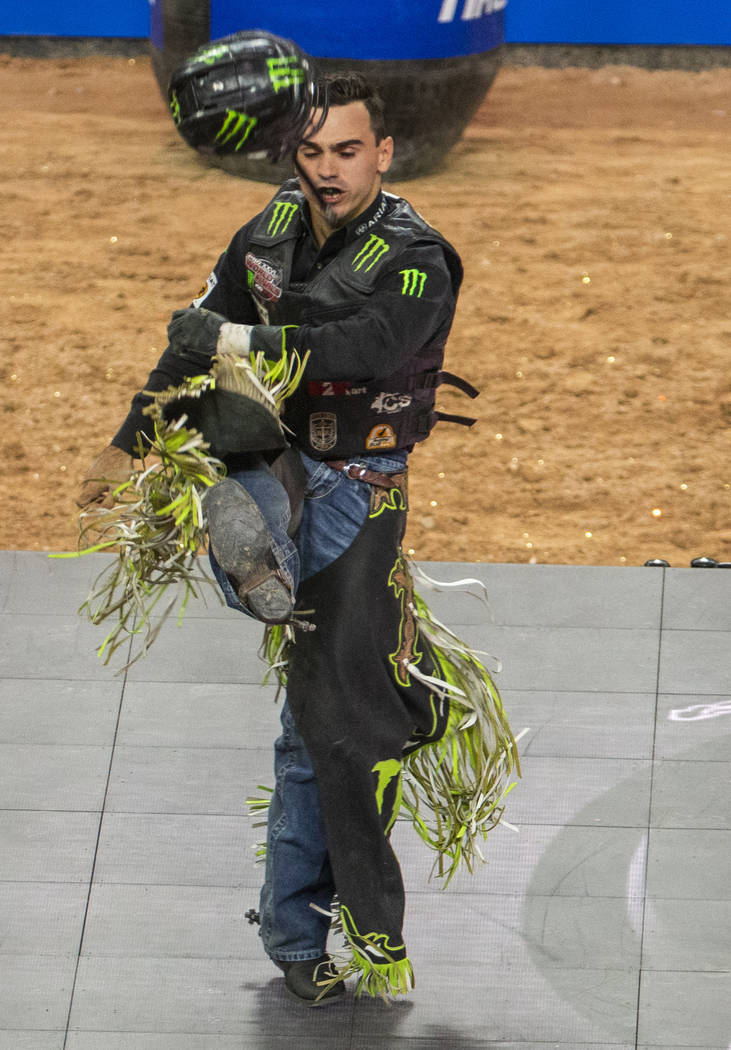 Jose Vitor Leme kicks his helmet after a successful ride atop of Cochise during the last day of ...