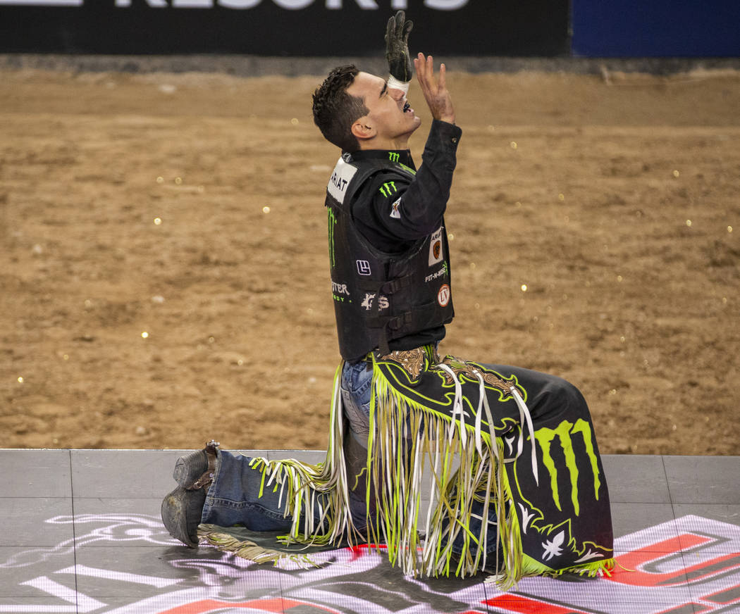 Jose Vitor Leme gives thanks after a successful ride atop of Cochise during the last day of the ...
