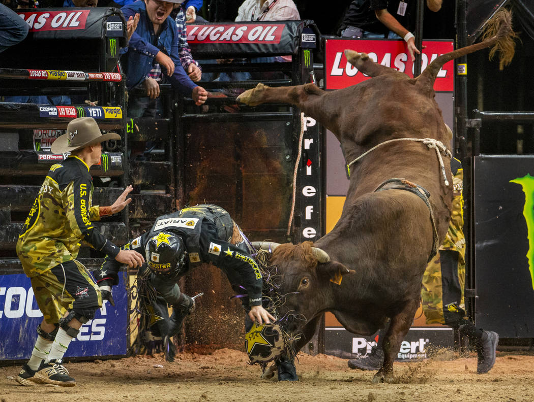 Matt Triplett is sent flying with a shot from Bezerk during the last day of the PBR World Final ...