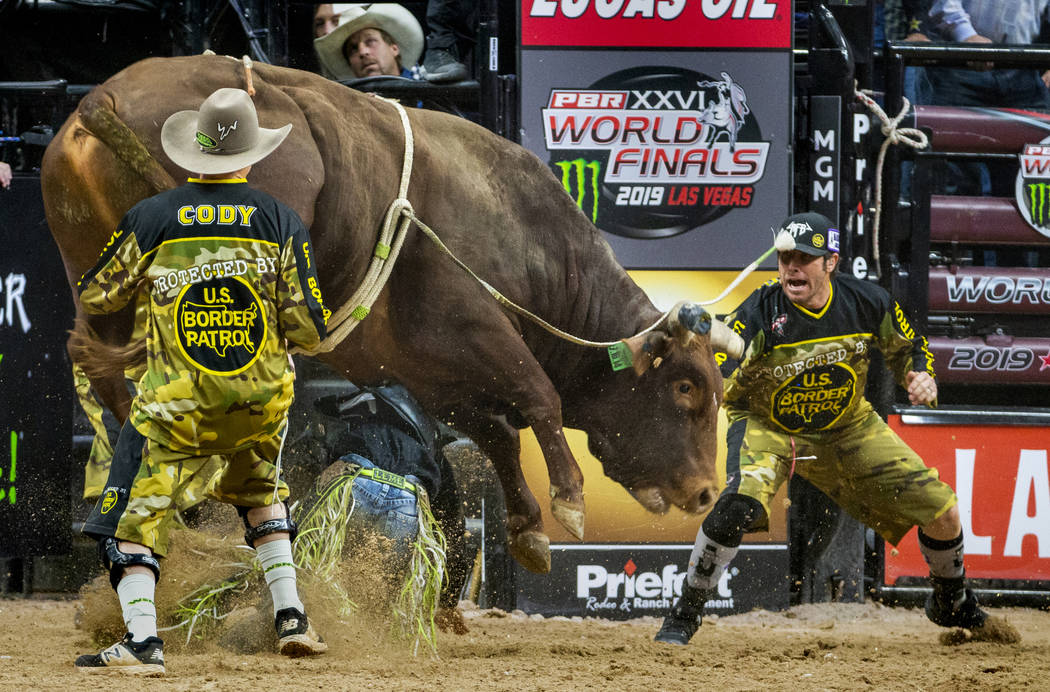 Jose Vitor Leme is pounded on beneath of Lil 2 Train during the last day of the PBR World Final ...