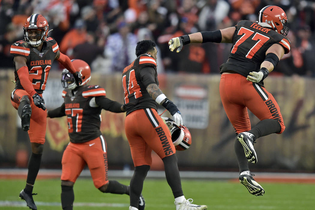 Cleveland Browns cornerback Denzel Ward (21) and teammates celebrate after they defeated the Bu ...