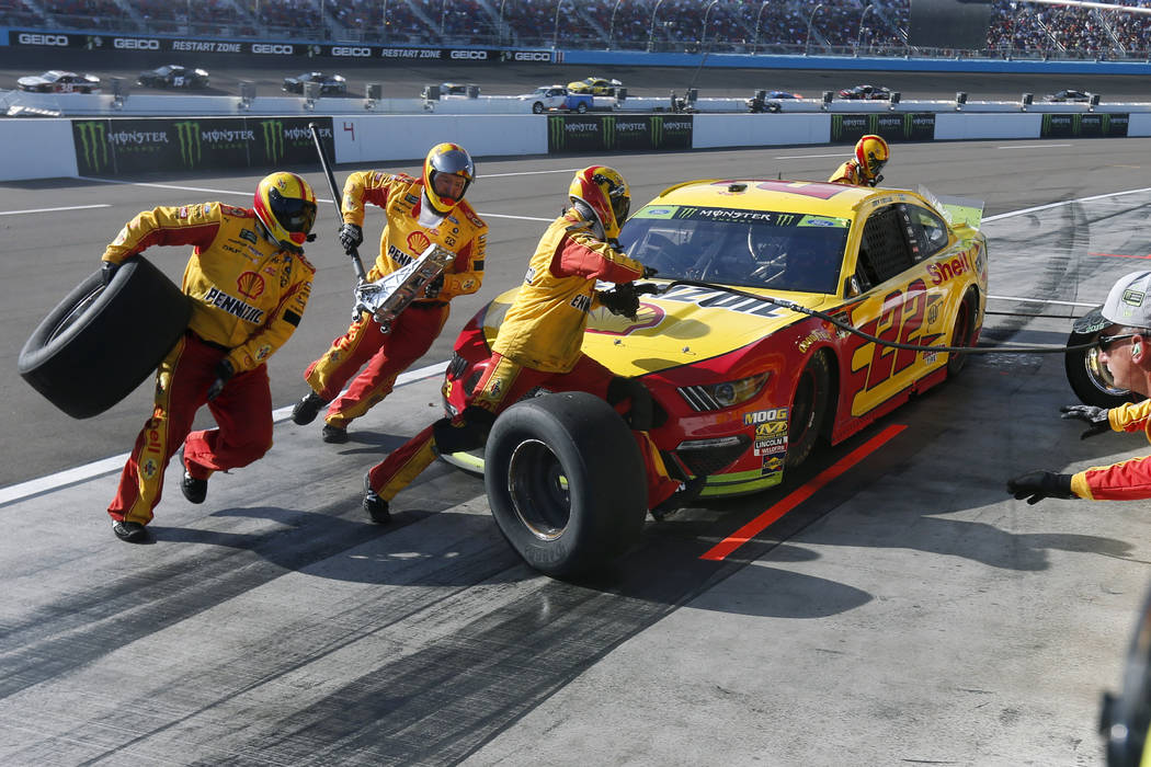 Joey Logano makes a pit stop during the NASCAR Cup Series auto race Sunday, Nov. 10, 2019, in A ...
