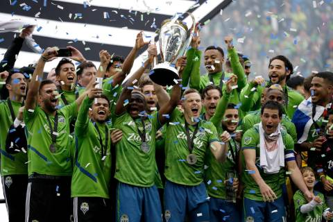 Seattle Sounders celebrate Sunday, Nov. 10, 2019, after the team beat the Toronto FC in the MLS ...
