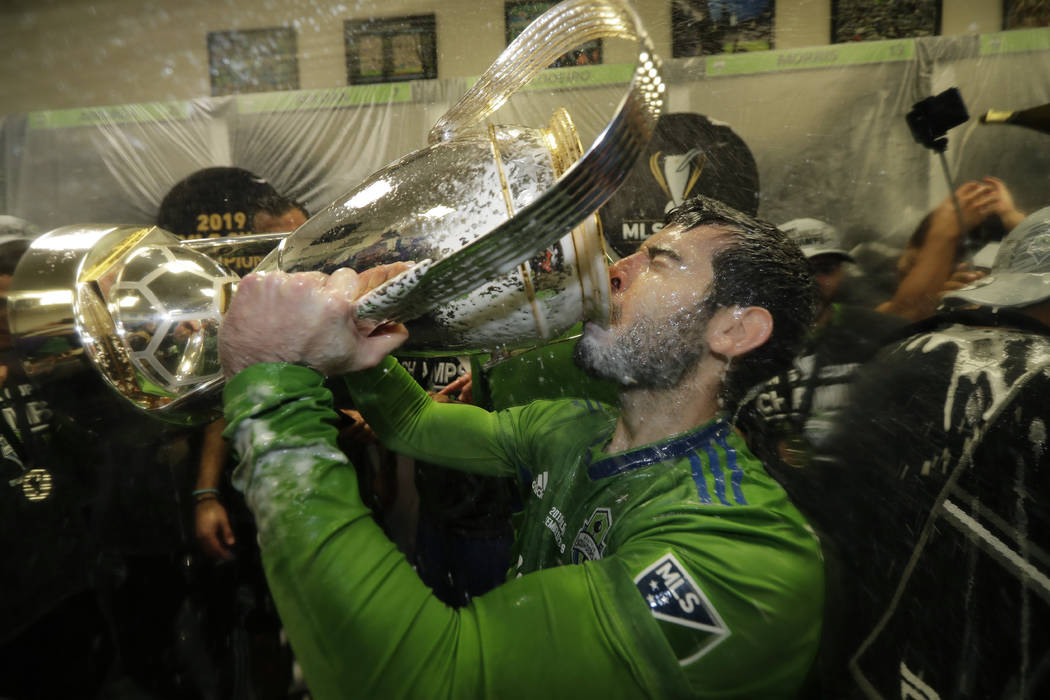 Seattle Sounders' Victor Rodriguez, who scored a goal in the match, drinks from the cup Sunday, ...