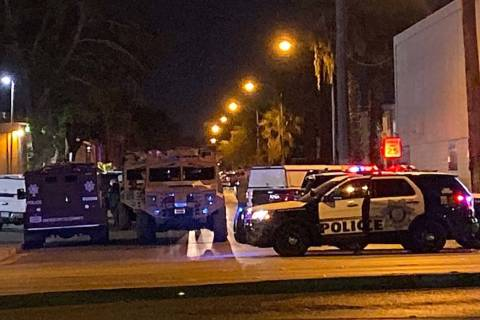 Metropolitan Police Department SWAT and patrol vehicles at a barricade event near Van Patten an ...