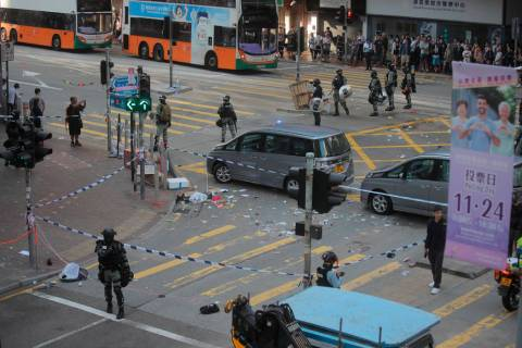 Police cordons off the scene of a morning shooting in Hong Kong Monday, Nov. 11, 2019. Police i ...