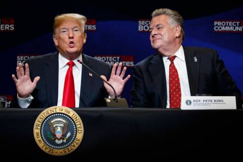 In a May 23, 2018, file photo, Rep. Peter King, R-N.Y., right, listens as President Donald Trum ...