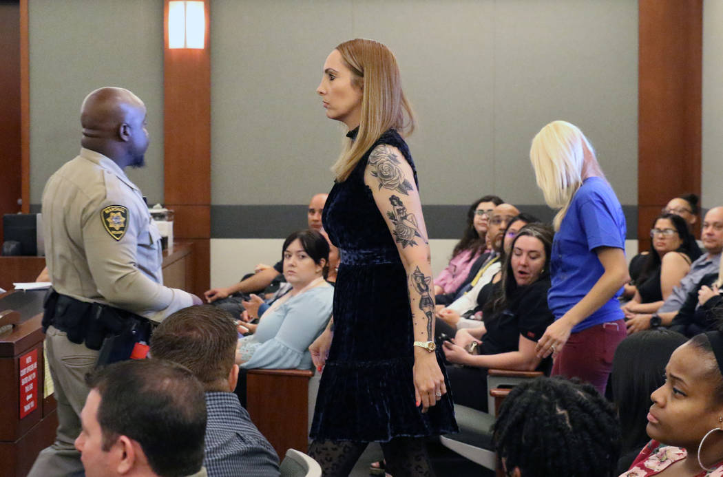Suspended attorney Alexis Plunkett enters the courtroom for her sentencing at the Regional Just ...