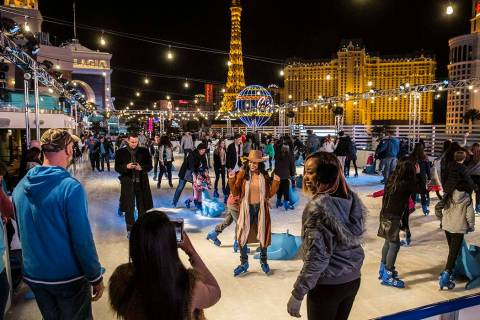 Skaters take advantage of a mild December day to enjoy The Cosmopolitan of Las Vegas Ice Rink o ...