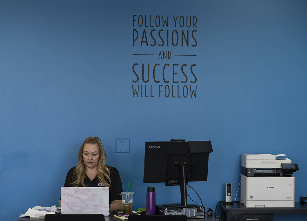Michelle King, part-time registrar, works at her desk at Acceleration Academy in Las Vegas, Sun ...