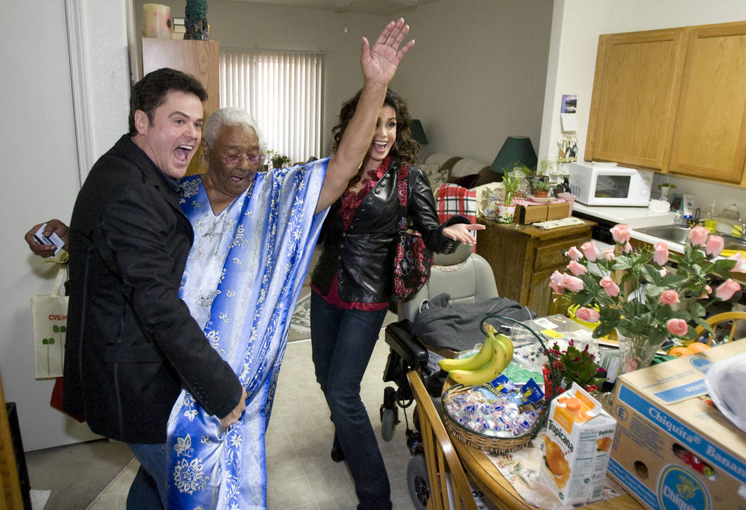 Donny Osmond does a dance move with Barbara Wilson, 74, as Marie looks on at Louise Shell Senio ...