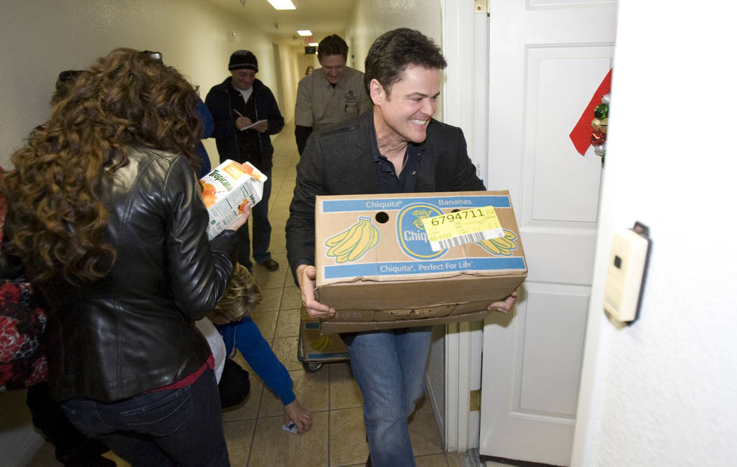 Donny and Marie Osmond deliver food at Louise Shell Senior Apartments, 2121 N. Martin Luther Ki ...