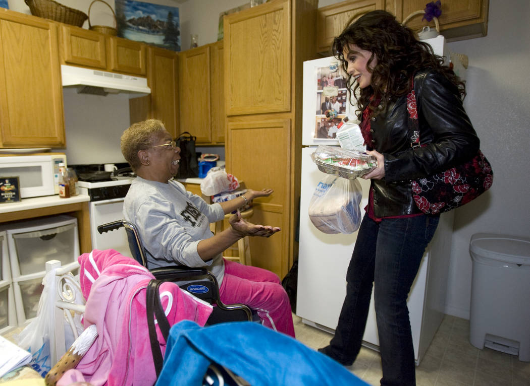 Marie Osmond delivers food to Mary Boyer, 65, at Louise Shell Senior Apartments, 2121 N. Martin ...