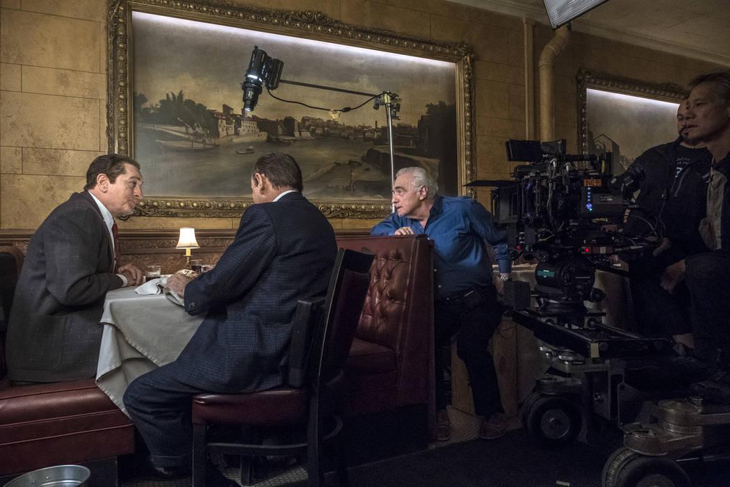 Martin Scorsese directs Robert De Niro and Joe Pesci in a scene from The Irishman. Photo Credit ...