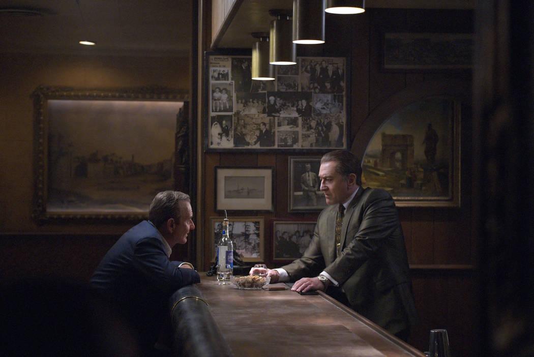 Russell Bufalino (Joe Pesci) and Frank Sheeran (Robert De Niro) talk business. Photo Credit: Ni ...