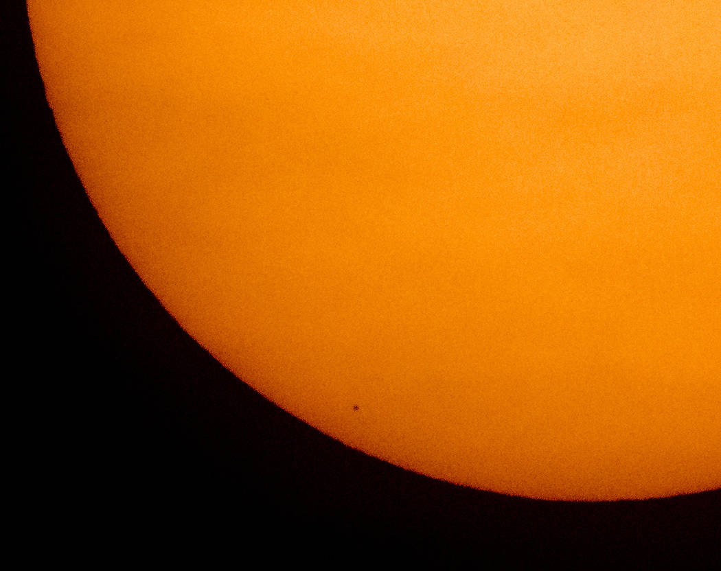 This image provided by NASA shows the planet Mercury in silhouette, low center, as it transits ...