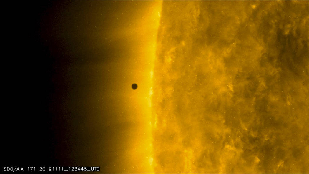 This still image from video issued by NASA's Solar Dynamics Observatory shows Mercury as it pas ...