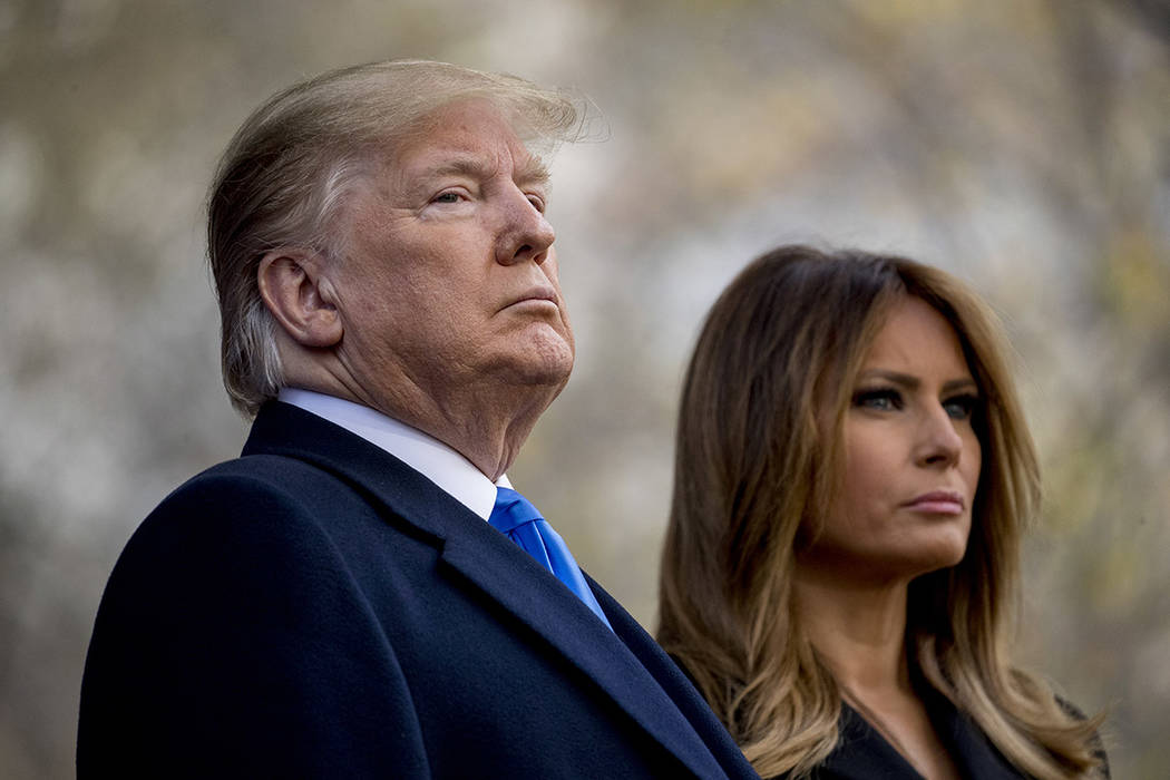 President Donald Trump and first lady Melania Trump participate in a wreath laying ceremony at ...