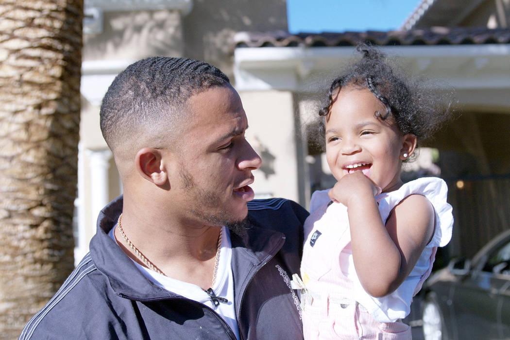 Raiders rookie safety Johnathan Abram holds his 2-year-old daughter, Harlee, while house huntin ...