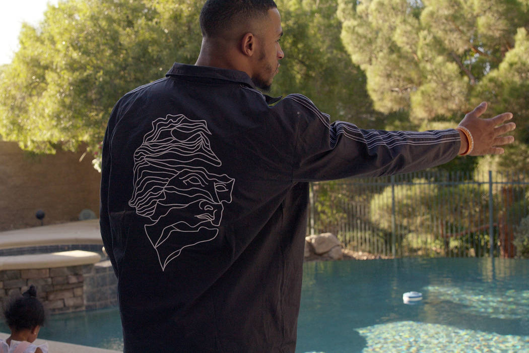 Raiders rookie safety Johnathan Abram takes a look at the pool and backyard of a home in the La ...